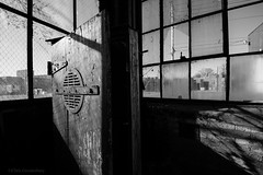 Insignificance | Cannery Ironworks (FloodSpectre) Tags: windows shadow blackandwhite abandoned wooden industrial darkness urbandecay locker urbanexploration brokenwindows ue ironworks urbex tumblrd canoneos60d sigma816mmf4556dchsmultrawidezoom