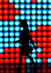Disco Walk (C_MC_FL) Tags: street blue light red woman reflection rot silhouette night canon disco person photography eos austria tirol sterreich fotografie dynamic nacht walk fav20 pop blau frau tamron fav30 tyrol innsbruck lichter gehen reflektionen umris fav10 kontur strase fav40 18270 dynamisch 60d b008
