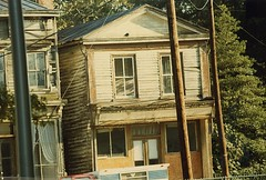 Crosswicks St Old Buildings 1979b (jannetie) Tags: railroad trees houses windows cats house water architecture sailboat creek train docks cat river boats restaurant pier newjersey apartments doors furniture colonial victorian sandbar trains shore canoes storefront curtains sailor sailboats siding renovation clapboard mercercounty delawareriver yachtclub shipbuilding boater boatclub canoer vintagephotographs sheers vintagephotograph crosswickscreek bordentown burlingtoncounty trentonnj duckisland bordentownnj yapewi yapewiaquaticclub bordentowncity crosswicksstreet sweetheartcurtains tiebackcurtains crisscrosscurtains crosswicksroad