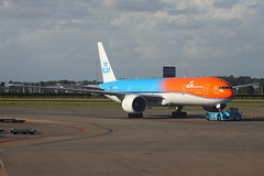 "KLM Boeing 777-300ER PH-BVA ""Orange Pride"", 9-Aug-2016 (Sergey Kustov) Tags: airport airfield aerodrome ramp apron gate runway taxiway pushback departure tug takeoff arrival landing touchdown airplane aircraft airliner jet airline boeing netherlands holland schiphol ams eham amsterdam 777300er phbva klm royal dutch airlines special livery orange pride olympic"