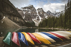 Moraine Lake Canoes (TheReilDeal) Tags: banff banffnationalpark morainelake valleyofthetenpeaks mountains lake glacier alberta canoes colors filter