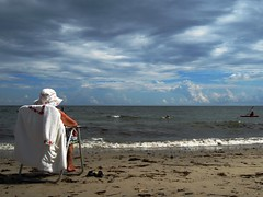 A woman on the beach at high tide during an impending thunderstorm over Long Island Sound. Milford, Connecticut. August 2016. (wavz13) Tags: milford woodmont beaches thunderstorms darkclouds stormclouds storms threatening oceans swimmers kayaks southernconnecticut connecticutshoreline newengland beachchairs beachsand swimming cumulusclouds cumulus lightningstorms seaweed marine marinelife waves whitecaps storm beachhats beachlight lightandshadow shadowandlight threateningclouds connecticutbeaches newenglandbeaches milfordbeaches connecticutphotos connecticutphotography newenglandshoreline women females grayskies greyskies thunderheads sand sandybeaches connecticutphoto connecticutphotographs thunder thunderstorm surreal puffyclouds angelicclouds eerie stange odd unusal