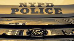 NYPD (nyanc) Tags: macromondays planestrainsandautomobiles nypd newyork newyorkcity america ford car reflection timesquare police logo macro manhattan nyc ny broadway skyscraper