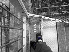 Arles Amphitheatre (AmyEAnderson) Tags: bw blackandwhite arles provence france bouchesdurhone historic roman romanesque bleachers seats texture depthoffield shoe blue amphitheatre coliseum stadium downward standing lines railing shadows unesco