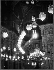 Tinkling Lights (Firery Broome) Tags: lights decorative glowing circular architecture historic historicplaces historicicons mosqueofmuhammadali alabastermosque citadel cairo egypt africa scaredplaces panasonic panasonicfz20 photoshop nik viveza alienskin exposurex blackandwhite blackwhite bw blackandwhitearchitecture monochrome dof light sunlight streamsoflight glow travel worldtravel 365
