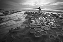 Potholes Surfer (ernogy) Tags: ocean california ca sunset sea sky blackandwhite usa seascape storm reflection beach nature water silhouette clouds landscape coast pacific sandiego outdoor surfer lajolla surfboard coastline southerncalifornia thepotholes ernogy hospitalreef