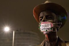 Mini Banner mask on statue outside South Kensington tube station, Chelsea London