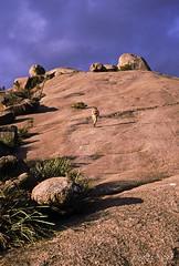 Climbing The Pyramid, 1996 (NettyA) Tags: park canon rocks fuji child 1996 australia boulders velvia national scanned qld queensland granite carrying girraween eos500 thepyramid 35mmslidefilm granitebelt bushwalker
