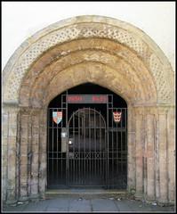 Norman doorway - anyone know it? (pefkosmad) Tags: door uk england bristol memorial gate heraldry norman doorway worldwarii gateway shield romanesque devices wartime secondworldwar heraldic