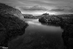 Sunlit Castle (Dave Brightwell) Tags: bw seascape beach clouds canon reflections coast rocks northumberland hitech redsnapper bamburghcastle bwnd davebrightwell