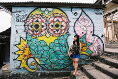 Blue Point   (ChrisLCW) Tags: travel portrait bali slr film indonesia graffiti owl wendy bluepoint nikonf80 fujifilmpro400h afsnikkor1635mmf4gedvr