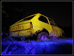 Yellow Ford Fiesta (Jon 89) Tags: lighting old uk greatbritain nightphotography blue light england colour english classic cars ford abandoned overgrown graveyard up field car wheel yellow metal night rural forest woodland dark walking countryside photo back site woods rust fiesta exterior view unitedkingdom britain near walk wheels rusty dump scene location collection torch bourn filter vandalism gb damage vehicle disused british rusting lit smashed wreck damaged scrap derelict gels cambridgeshire wrecks torchlight p7 dumped vandalised damages mk1 2013 ledlenser caxtonend