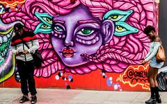 oblivious to the beauty (PDKImages) Tags: street city windows girls urban streetart london art girl beauty graffiti women scenery rooftops faces skin camden stripes murals caged shoreditch walls contrasts owls