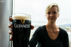 Woman Out of Focus Holding Frosty Dark Guiness Beer (HunterBliss) Tags: aclohol advertisement bar beer black bokeh class cold condensation dark delicious depthoffield drink dublin europe foam focus frosty full galss gravity guiness hand head high hold holding ireland lager logo model pint storehouse window
