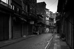 Empty streets / The remaining few (zgr Grgey) Tags: 2016 35mm bw d750 nikon samyang unkapan empty street istanbul turkey