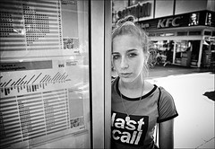 Last Call (Steve Lundqvist) Tags: germany germania berlin berlino girl street portrait call last shirt tshirt collar makeup eyes bus train deutschland sadness sad travel traveller nikon 24mm d700 closeup kfc cast casting model fashion moda woman clothes wearing vestito top teen teenager young time timetable