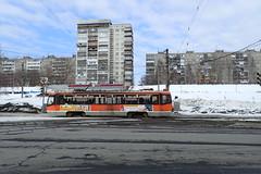Classic (8pl) Tags: tram tramway building immeubles neige perm russie hiver orange bitume glace publicités