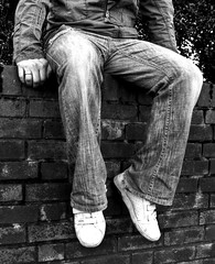 Modern Killip (Uncle Berty) Tags: chris killip torso inspired modern outtake remake version inspiration black white bnw bw texture grainy jeans trainers coat legs feet hands brick wall sitting sat college project level