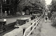"Oxford / England: Narrowboat ""Delta"" passing bridge No. 243 and Isis lock (wwwuppertal) Tags: oxford england oxfordshire uk unitedkingdom greatbritain grosbritannien oxfordcanal schleuse lock bridgeno243 schleusentor skipper isislock gate sw schwarzweis bw blackandwhite noiretblanc blancetnoir monochrome monochrom getont toned tonung toning fujifilmxpro1 fujinonxf35mmf2rwr fujifilmxsystem"