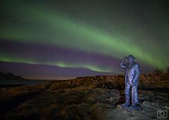 The statue Jón Ósmann and aurora borealis - Iceland (Arnar Bergur) Tags: ocean winter sea sky mountain green statue stars landscape iceland northernlights auroraborealis phenomenon skagafjordur arnarbergur jonosmann