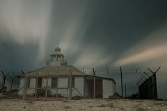 Akrotiri Lighthouse (Geno33) Tags: longexposure sunset lighthouse building nature beautiful beauty night clouds canon eos coast long exposure slow wind mark iii cyprus shutter 5d dslr oldbuilding 24105l 5dmk3