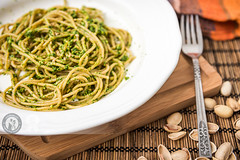 Spaghetti with Ramsons Sauce (Cristian Sabau | Photography) Tags: stilllife kitchen vertical photography rustic tasty plate fork nopeople indoors pistachio meal basil spaghetti foodanddrink herb cuttingboard selectivefocus ramson maincourse colorimage pestosauce flaxseed