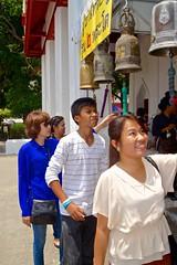 Ringing the bells at Wat Rakhang, Bangkok, Thailand (UweBKK (α 77 on )) Tags: portrait people bells thailand religious temple worship asia bell bangkok buddha buddhist sony religion social ring sacred southeast alpha dslr wat ringing 550 rakhang watrakhang 9templestour