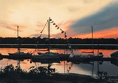 Yapewi Sunset_Sailboats abt 1980 (jannetie) Tags: railroad trees windows sunset beach water architecture sailboat creek train docks river reeds boats island pier canal newjersey twilight dock ramp doors furniture rustic nj sailors sandbar sunsets trains ramps flags canoe shore canoes boardwalk sailor canoeing sailboats floats mercercounty canoeclub delawareriver yachtclub shipbuilding bulkhead boater boatclub delawareraritancanal canoer vintagephotographs vintagephotograph crosswickscreek bordentown burlingtoncounty trentonnj duckisland bordentownnj canoers rusticarchitecture burgees yapewi yapewiaquaticclub