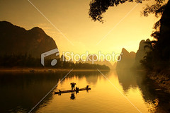 Fishing (MPBHAIBO) Tags: china morning travel mountain reflection river landscape dawn liriver fisherman asia dusk guilin yangshuo hill bamboo cormorant   lijiang traditionalculture  chineseculture    mountainpeak asianculture   asianethnicity karstformation nauticalvessel chineseethnicity woodenraft  guangxiregion