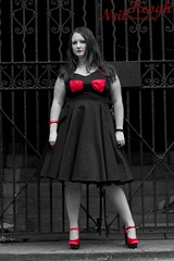 IMG_4518 (Neil Canon Keogh) Tags: red black vintage necklace highheels dress retro ring redhead bow buskers bracelet heels rockband pinup pinupgirl trianglesquare manchestercitycenter dressmodellaura