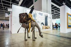 Mixed Media Sculpture by Samsul Arifin (b.1979): Musafir Artist #1, 2013 (Goni: Resin, leather, jute, steel, wood) / Nadi Gallery / Art Basel Hong Kong 2013 / SML.20130523.6D.13970 (See-ming Lee  SML) Tags: china wood urban sculpture hk art leather cn indonesia photography hongkong crazy acrylic mixedmedia character events avatar fineart paintings photojournalism canvas camel jakarta creativecommons  resin wtf   hkg journalism  6d goni artbasel  canon1740f4l   2013  ccby seeminglee canonef1740f4lusm canon6d smlprojects crazyisgood  smlfineart smluniverse nadigallery canoneos6d smlphotography smlevents flickrstats:views=10000 flickrstats:views=5000 abhk sml:projects=crazyisgood fl2fbp sml:projects=photojournalism sml:projects=smlfineart artbaselhongkong2013 samuelarafin