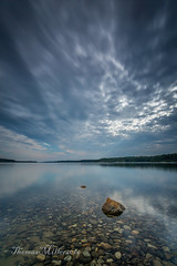 Moody skies (the SkyHum) Tags: landscape sky clouds water longexposure lake rocks reflection nature newengland massachusetts