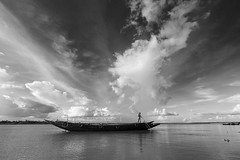 ~The sky's the limit. (Tapas Ghosh Photography) Tags: opensky sky monsoon monsoonsky boat boatride sundarban river westbengal landscape travel travelphotography clouds fisherman freedom life incradibleindia india blackwhite blackandwhitelandscape amazing nature weather journey asia floating beach beauty streetphotography