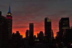 FireSunsetNewYorkL (elizaroff) Tags: manhattan manhattanrooftops manhattanskyline skyline skyscrapers newyork nyc september 2016 empirestatebuilding esb lights laborday
