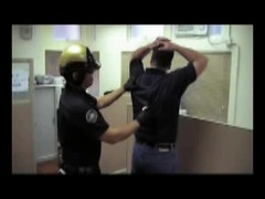 Applying blue box to handcuffs (asiancuffs) Tags: handcuffs handcuffed arrest arrested prisoner inmate shackles shackled