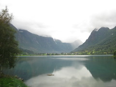 Norwegian (VERUSHKA4) Tags: travel summer sky mountain snow reflection tree green nature water norway fog stone canon landscape norge waterfall europe day village country august norwegian shore fjord scandinavia hordaland verdure fylke