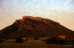 Sunrise on Mt Maroon, 1994 (NettyA) Tags: mountain rock clouds sunrise canon fuji mt maroon australia farmland velvia bushwalking scanned queensland 1994 rhyolite seq eos500 35mmslidefilm mtbarneynationalpark