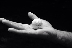 (The Sassy Scorpio) Tags: blackandwhite bw white black ball golf hand golfing titleist golfball uploaded:by=flickrmobile flickriosapp:filter=nofilter