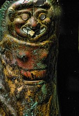 Closeup of Bronze Greaves with Bone Inlay engraved with images of a Gorgon Greek Apulia Italy 550-500 BCE (mharrsch) Tags: italy oregon portland soldier greek armor 6thcenturybce warrior britishmuseum armour mythology gorgon hoplite apulia portlandartmuseum greaves bodybeautiful mharrsch