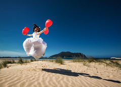 red balloons (green.pit) Tags: portrait beach girl jump spain nikon balloon explore laredo d800 1635 comunin pitgreenwood
