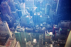 Blue City (emibell) Tags: city nyc newyorkcity winter sunset urban ny newyork skyline buildings holidays december skyscrapers manhattan rockefellercenter midtown newyorkskyline viewpoint 2009 christmastime topoftherock winterbreak winterfun cityview newyorkbuildings midmanhattan kodakdisposable winterwanderings emibell