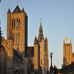 Three towers - Ghent, Belgium (Lsnoeren88) Tags: blue sunset sky cloud sun sunlight building tower history church saint yellow clouds square nikon europa europe cathedral belgium belgie flag towers may churches belgi sint flags medieval nicholas belfry squareformat 1855mm mei nikkor ghent gent kerk belfort kathedraal flanders vlag bavo vlaggen vlaanderen sintniklaaskerk sintbaafskathedraal 2013 d5000 niklaaskerk
