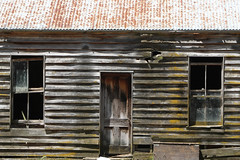 A colonial farm house that somehow still survives, Southland, New Zealand (brian nz) Tags: abandoned old dilapidated derelict house building home farmhouse farm sheep southland newzealand nz oldandbeautiful aged wooden firre fireplace decaying decay rural