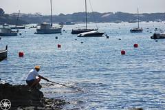 Pescador (Gerard Gesali) Tags: summer fisherman mediterranean sea fish coast sky boats blue photographer photography old cadaqus catalunya