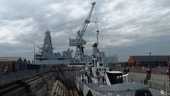 Portsmouth Dockyard (mr broddy) Tags: phdockyard dockyard portsmouth monitor m33 hmsdaring drydock crane shed people mast gun radar funnel ship wwi gallipoli dazzle
