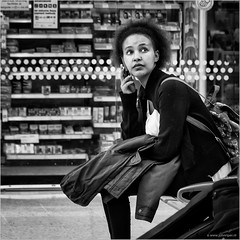 I'm not gonna make it in time... (John Riper) Tags: johnriper street photography straatfotografie square bw black white zwartwit mono monochrome candid john riper canon 6d 24105 l liverpool england uk people waiting limestreet limestreetstation woman phone calling ringing window coat jacket looking watching
