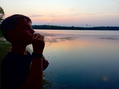 Blowing Bubbles at Sunset (webmastermama71) Tags: sunset sunsetphotography sunsetting water waterreflection silhouettes silhouettephotography reservoir colorfulsky treesilhouette bubbles blowingbubbles