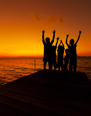 silhouette of children at sunset (Macbrian Mun) Tags: ocean life family friends boy sunset shadow red sea sky people orange cloud abstract black color cute beach nature water girl beautiful childhood silhouette kids youth clouds dark children landscape fun outside outdoors happy person freedom evening togetherness coast kid hands friend colorful paradise child play hand friendship arms artistic little outdoor many expression background small joy group creative young happiness scene human together enjoy sibling cheerful stretched joyful waving playful generation active