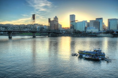 Portland Evening (Joe Wilson (Black Mirror)) Tags: city travel bridge blue sunset sky urban cloud sun reflection building water beautiful beauty skyline architecture modern clouds oregon skyscraper river portland evening boat town twilight scenery downtown cityscape peace dusk background scenic calming calm business serenity hawthornebridge backdrop serene beauties luxury willametteriver metropolitan watercraft waterway nightfall calmness settingsun blueish luxurious bluish anchored luxuries