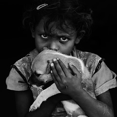 Mine... (Rakesh JV) Tags: life portrait people dog pet india black love girl monochrome animal mono humanity expression indian bond care blacknwhite chennai bnw tamilnadu portaiture cwc rjv indianportrait possesive brickfactory thirumazhisai nikond7000 chennaiweekendclickers nikon70200f28vr2 rakeshjv rakeshjvphotography rjvphotography